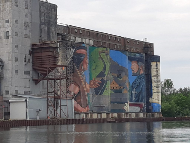 Midland Mural showing French Jesuit missionary and a Huron Indigenous person at Sainte-Marie Among the Huron.