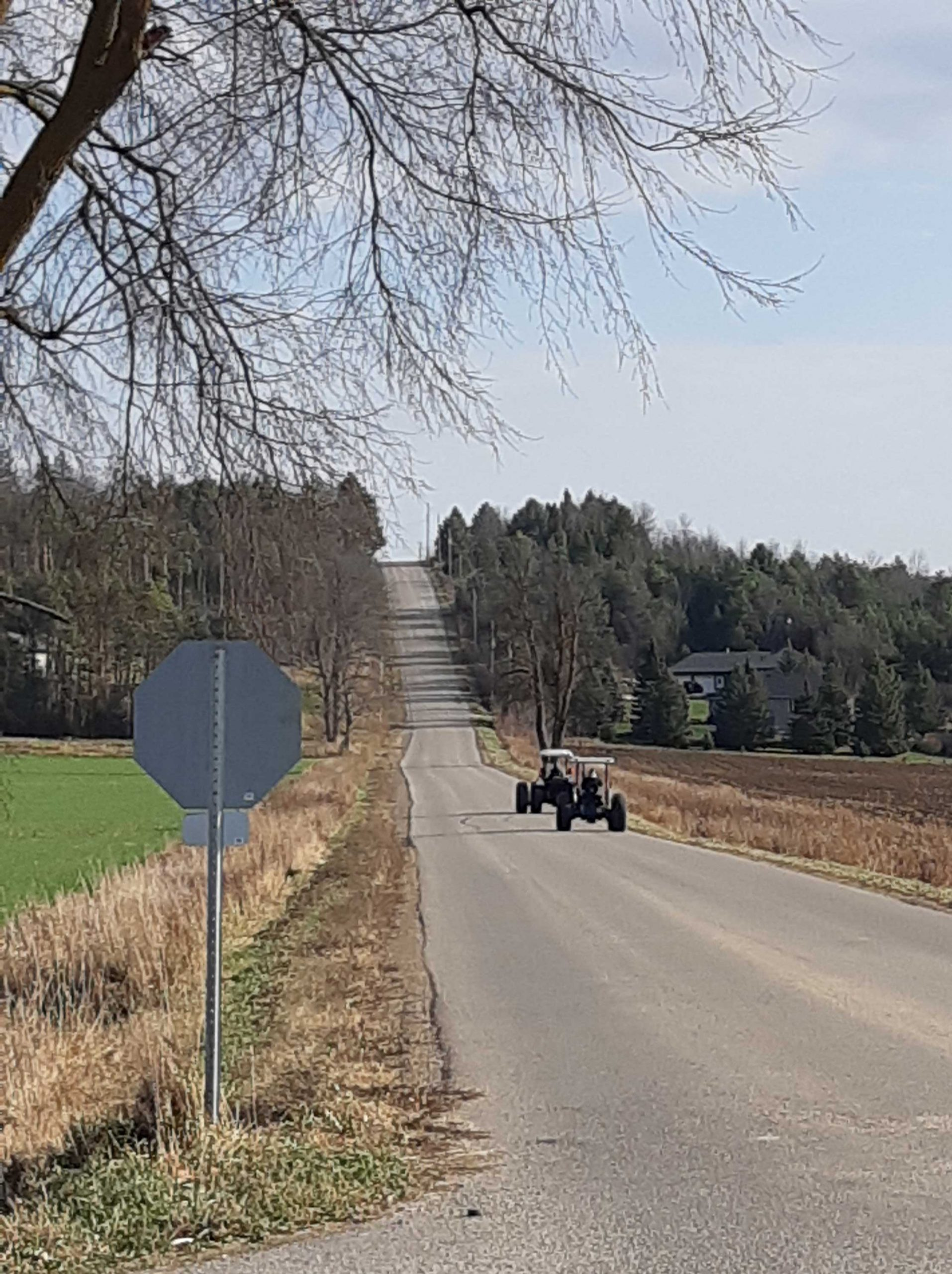 two small tractors on a country road