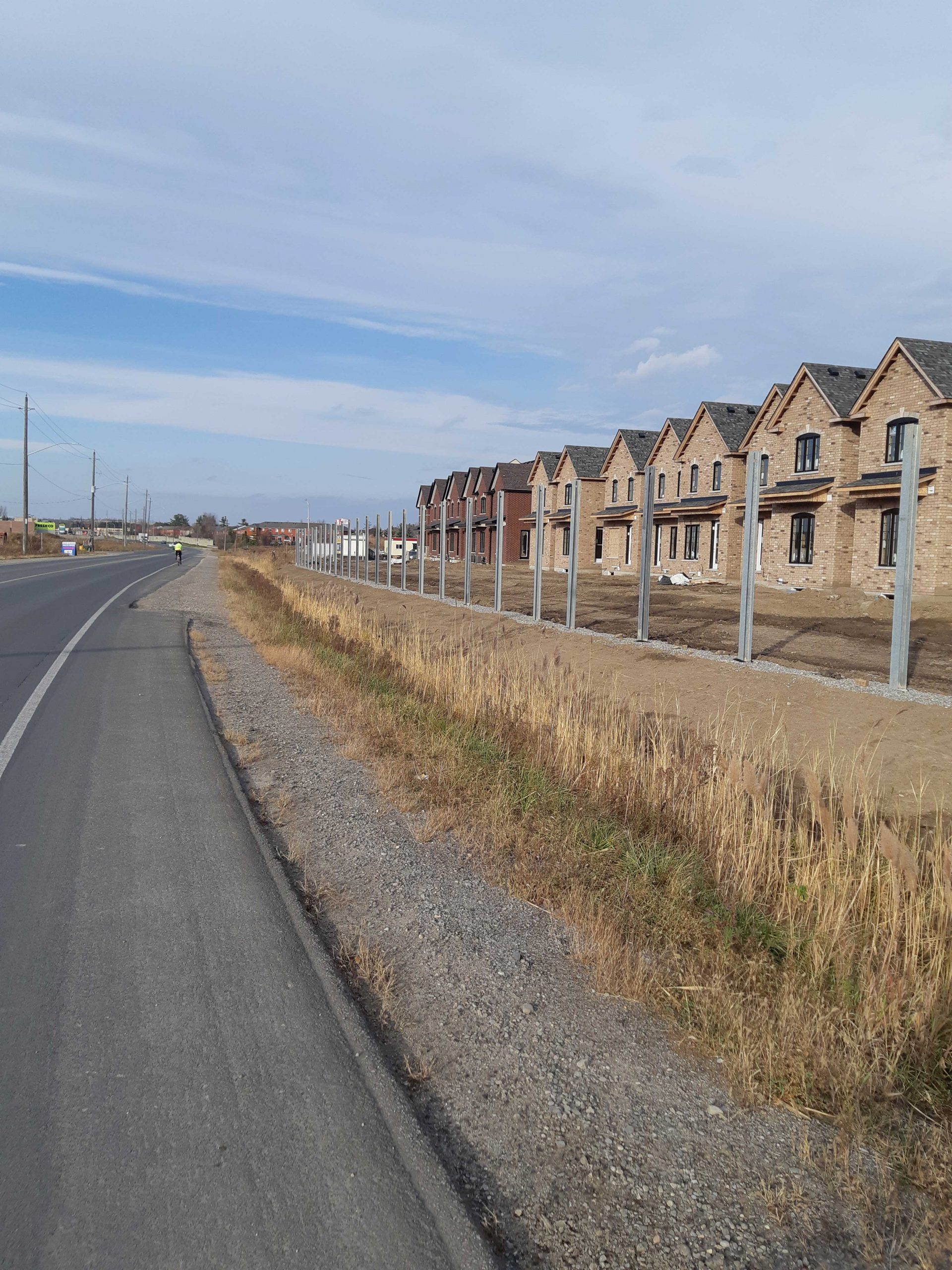 row of housing in the process of being built