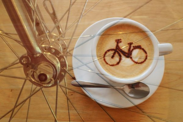 Cup of cofffee with bicycle wheel